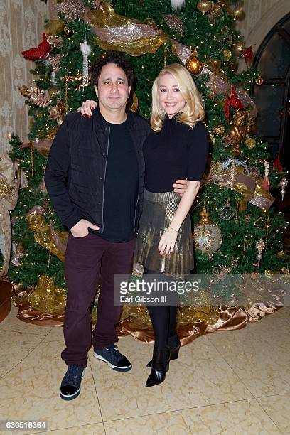 George J Maloof Jr and Kelly Carrington attend Adrienne Maloof's Annual Holiday Party with Never Too Hungover on December 24 2016 in Beverly Hills...