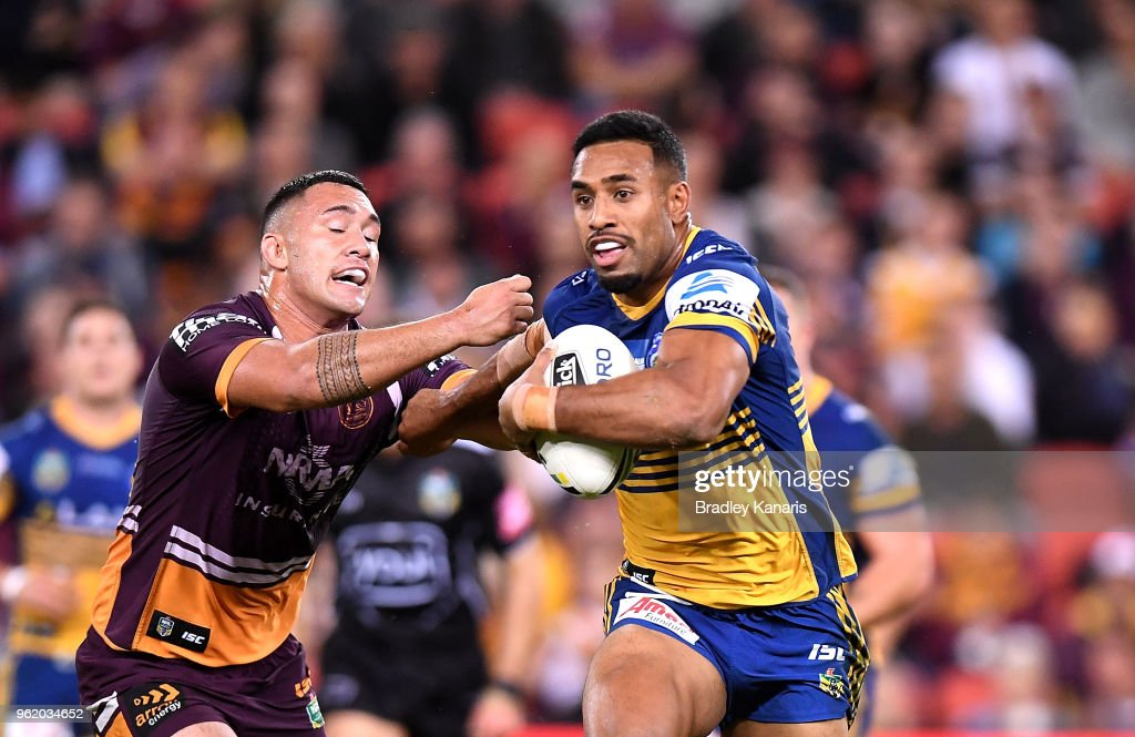 George Jennings of the Eels pushes away from the defence during the round 12 NRL match between the Brisbane Broncos and the Parramatta Eels at Suncorp Stadium on May 24, 2018 in Brisbane, Australia.