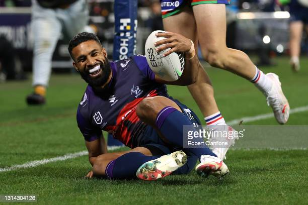 George Jennings of the Storm scores a try during the round seven NRL match between the Melbourne Storm and the New Zealand Warriors at AAMI Park on...