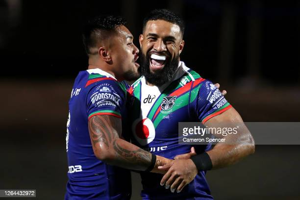George Jennings of the Warriors celebrates after scoring a try with Adam Pompey of the Warriors during the round 13 NRL match between the Manly Sea...