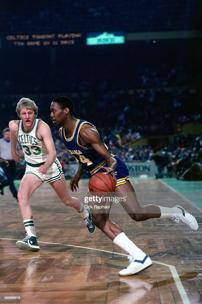 George Johnson #24 of the Indiana Pacers drives against Larry Bird #33 of the Boston Celtics during a game played in 1983 at the Boston Garden in Boston, Massachusetts.