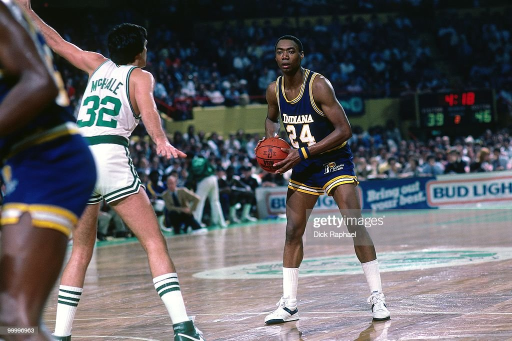 George Johnson #24 of the Indiana Pacers looks to make a move against Kevin McHale #32 of the Boston Celtics during a game played in 1983 at the Boston Garden in Boston, Massachusetts.