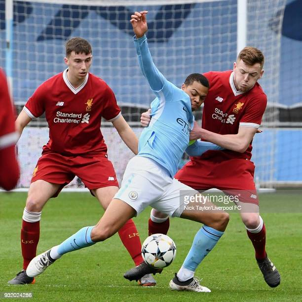 George Johnston and Conor Masterson of Liverpool and Lukas Nmecha of Manchester City in action during the Manchester City v Liverpool UEFA Youth...