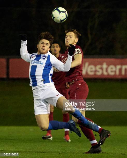 George Johnston of Liverpool and Aaron Connolly of Brighton and Hove Albion in action during the PL2 game at The Kirkby Academy on January 14 2019 in...