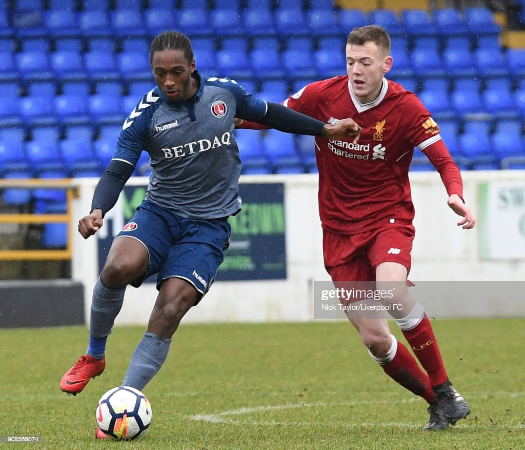 George Johnston of Liverpool and Brandon Hanlan of Charlton Athletic in action during the Liverpool U23 v Charlton Athletic U23 Premier League Cup game at The Swansway Chester Stadium on January 21, 2018 in Chester, England.