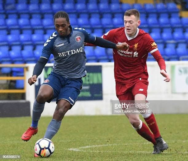 George Johnston of Liverpool and Brandon Hanlan of Charlton Athletic in action during the Liverpool U23 v Charlton Athletic U23 Premier League Cup...