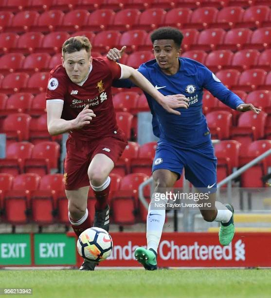 George Johnston of Liverpool and Jacob Maddox of Chelsea in action during the Liverpool v Chelsea PL2 game at Anfield on May 8 2018 in Liverpool...
