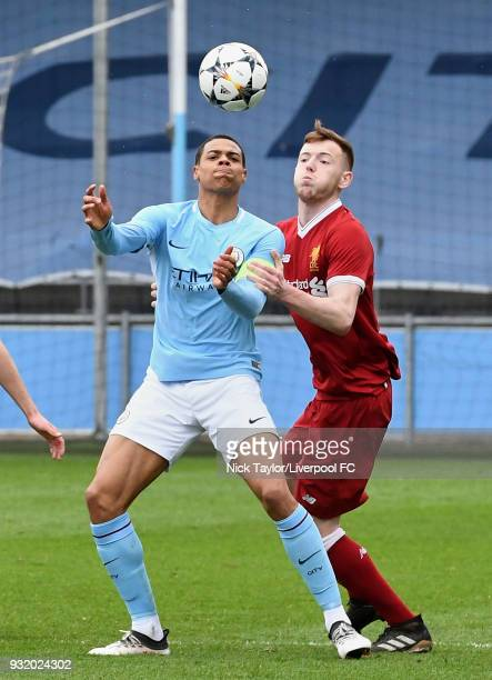 George Johnston of Liverpool and Lukas Nmecha of Manchester City in action during the Manchester City v Liverpool UEFA Youth League game at...