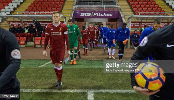 George Johnston of Liverpool leads his team onto the pitch at the start of the Liverpool v Porto Premier League International Cup game at Leigh...