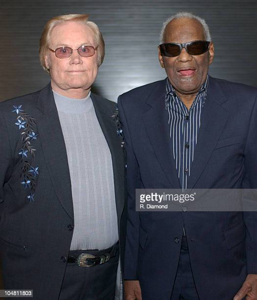 George Jones and Ray Charles during CMT 100 Greatest Songs of Country Music Taping to Air on Sunday June 8 2003 at Gaylord Center in Nashville TN...