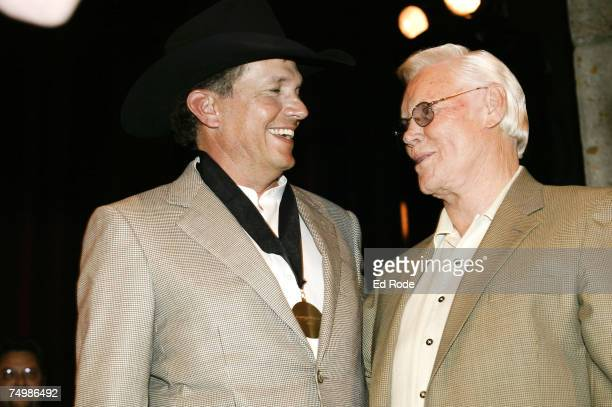 George Jones presents George Strait with his medallion during the 2007 Country Music Hall of Fame Medallion Ceremony