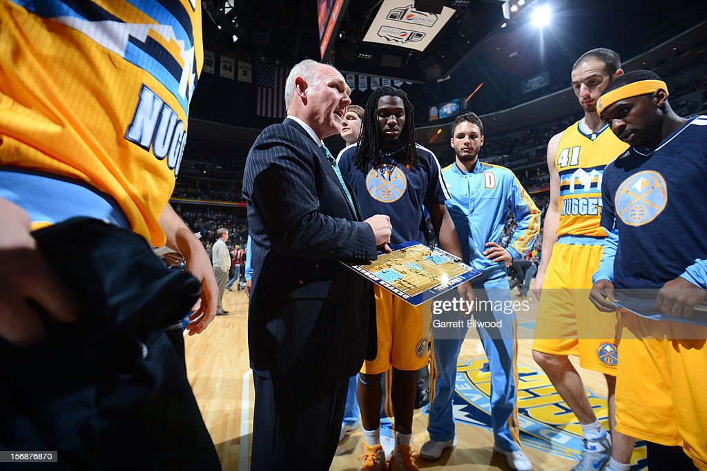 George Karl of the Denver Nuggets calling a play during a time out against the Miami Heat on November 15, 2012 at the Pepsi Center in Denver, Colorado.
