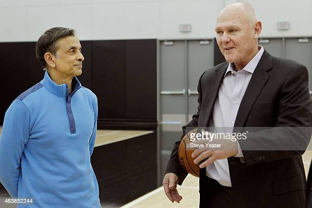 George Karl right visits with Kings owner Vivek Ranadive' after a news conference introducing him as the new head coach of the Sacramento Kings on...