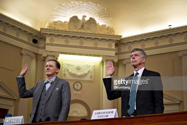 George Kent deputy assistant US secretary of state left and Bill Taylor acting US ambassador to Ukraine are sworn in during a House Intelligence...