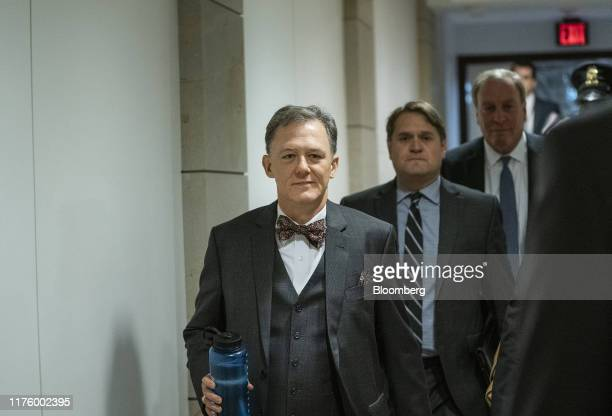 George Kent deputy assistant US secretary of state left arrives for closeddoor testimony before House committees on Capitol Hill in Washington DC US...