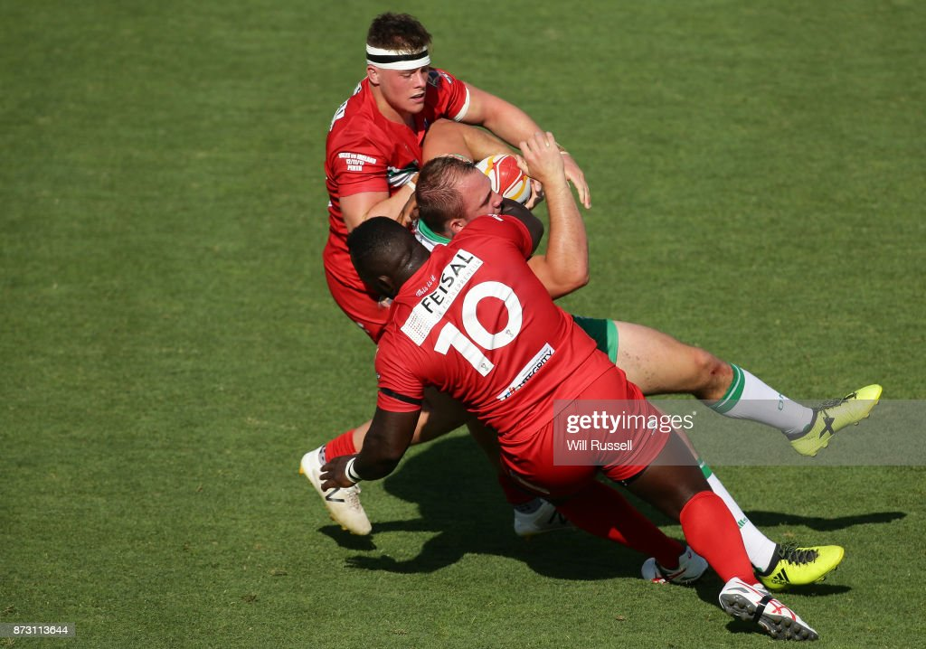 George King of Ireland is tackled by Philip Joseph of Wales during the 2017 Rugby League World Cup match between Wales and Ireland at nib Stadium on November 12, 2017 in Perth, Australia.