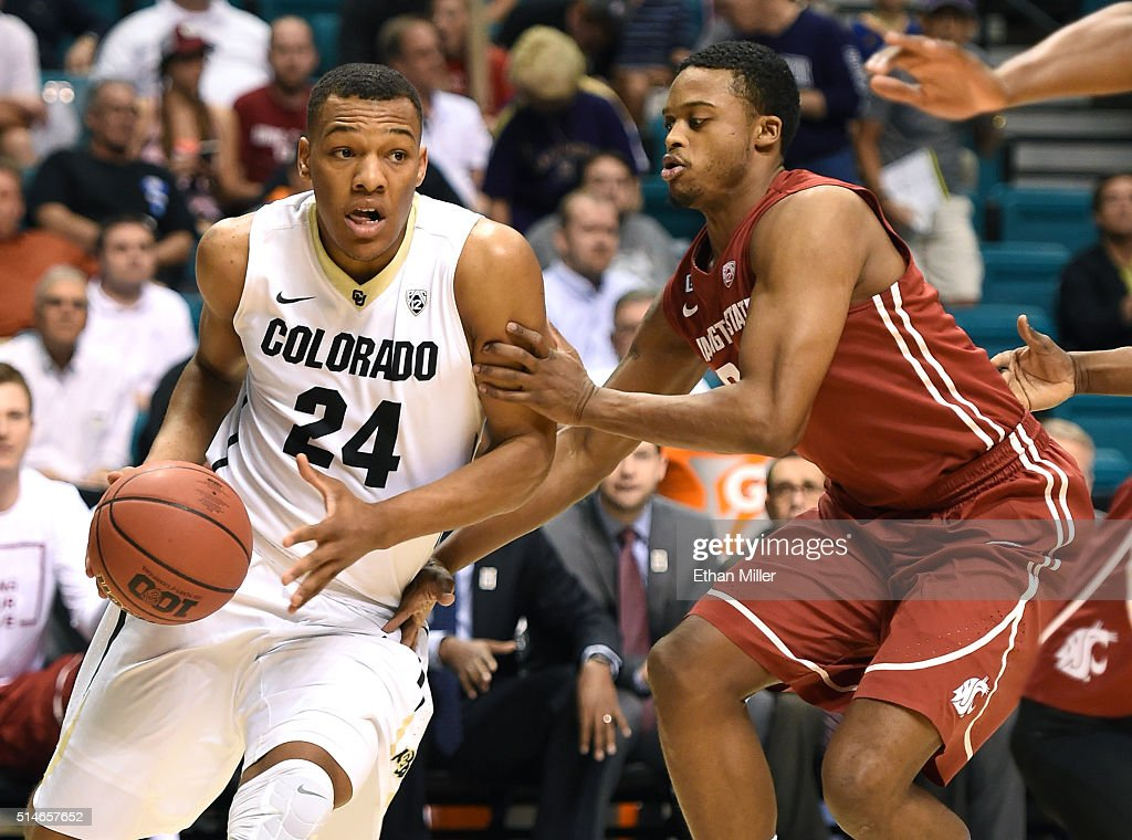 George King #24 of the Colorado Buffaloes drives against Que Johnson #32 of the Washington State Cougars during a first-round game of the Pac-12 Basketball Tournament at MGM Grand Garden Arena on March 9, 2016 in Las Vegas, Nevada. Colorado won 80-56.