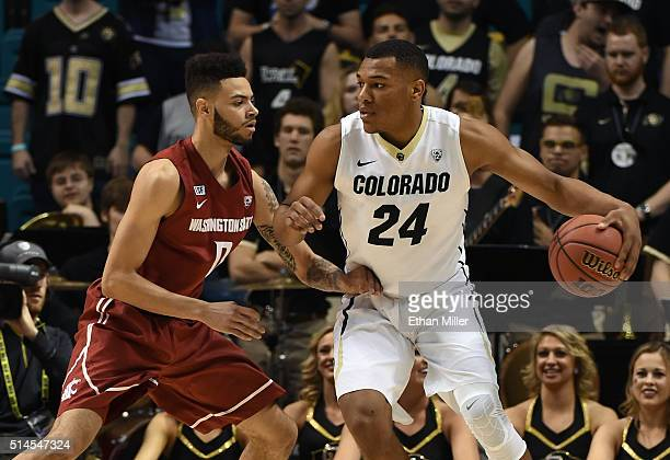 George King of the Colorado Buffaloes is guarded by Derrien King of the Washington State Cougars during a firstround game of the Pac12 Basketball...