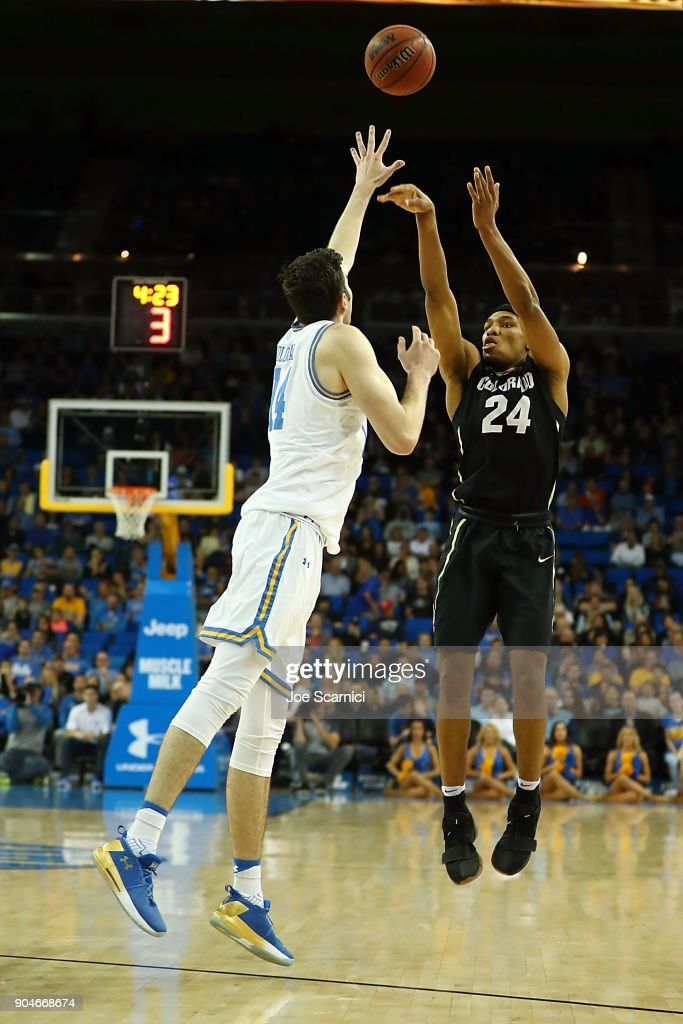 George King #24 of the Colorado Buffaloes takes a shot over Gyorgy Goloman #14 of the UCLA Bruins in the second half of the Colorado v UCLA game at Pauley Pavilion on January 13, 2018 in Los Angeles, California.