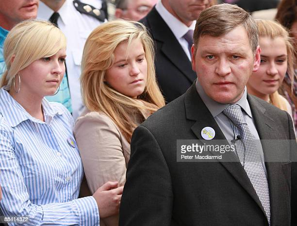 George Kinsella father of murdered schoolboy Ben Kinsella stands with his daughters Brooke Jade and Georgia outside the Old Bailey on June 11 2009 in...