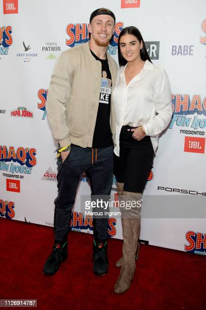 George Kittle and Claire Till attend Shaq's Fun House at Live! At The Battery on February 01, 2019 in Atlanta, Georgia.