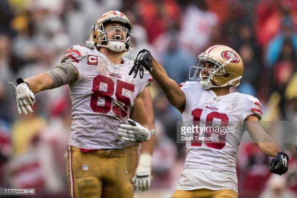 George Kittle and Dante Pettis of the San Francisco 49ers celebrate after a first down against the Washington Redskins during the second half at...