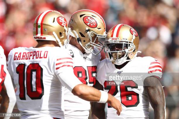 George Kittle and Jimmy Garoppolo of the San Francisco 49ers celebrate with Tevin Coleman after he rushed for a 19yard touchdown against the Carolina...