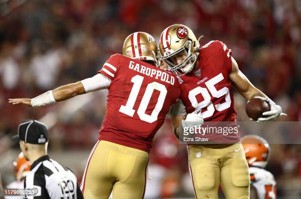 George Kittle is congratulated by Jimmy Garoppolo of the San Francisco 49ers after Garoppolo threw a touchdown pass to Kittle against the Cleveland...