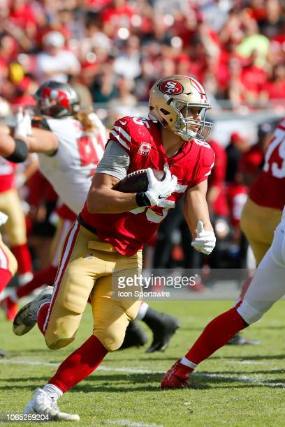 George Kittle of the 49ers runs with the ball during the regular season game between the San Francisco 49ers and the Tampa Bay Buccaneers on November...