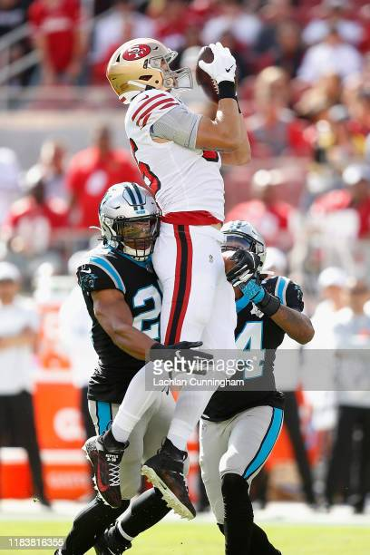George Kittle of the San Francisco 49ers catches a deflected pass by quarterback Jimmy Garoppolo in the first quarter against the Carolina Panthers...