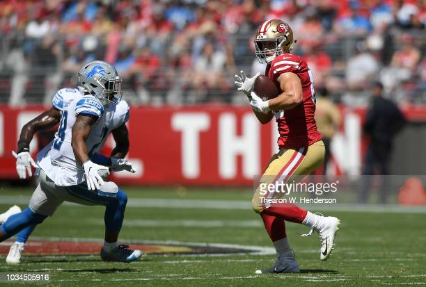 George Kittle of the San Francisco 49ers catches a pass against the Detroit Lions during the second quarter of their NFL football game at Levi's...