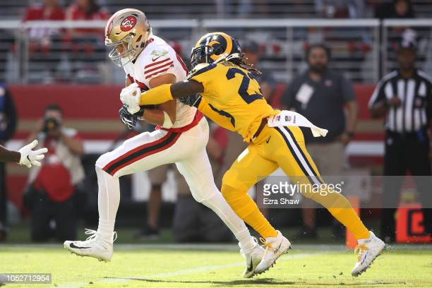 George Kittle of the San Francisco 49ers catches a touchdown in the endzone against Nickell RobeyColeman of the Los Angeles Rams during their NFL...