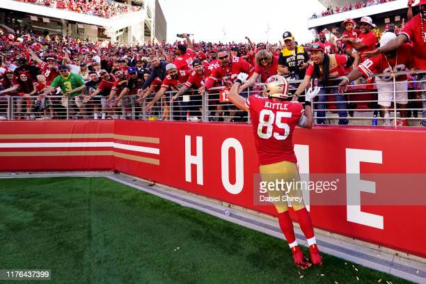 George Kittle of the San Francisco 49ers celeb rates with fans after beating the Pittsburgh Steelers at Levi's Stadium on September 22 2019 in Santa...