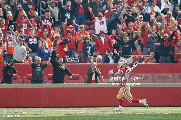 George Kittle of the San Francisco 49ers celebrates a touchdown against the Denver Broncos at Levi's Stadium on December 9 2018 in Santa Clara...