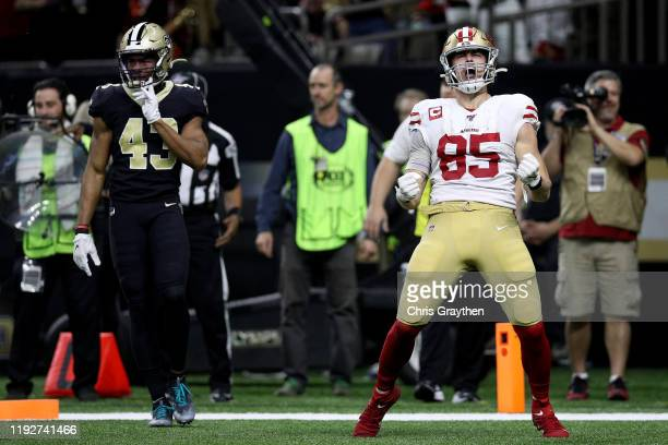 George Kittle of the San Francisco 49ers celebrates a touchdown against the New Orleans Saints during the third quarter in the game at Mercedes Benz...