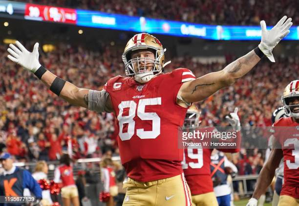 George Kittle of the San Francisco 49ers celebrates after catching a touchdown pass against the Los Angeles Rams during the second half of an NFL...
