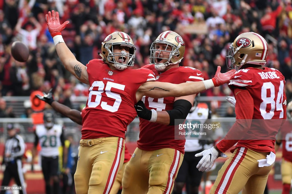 George Kittle #85 of the San Francisco 49ers celebrates after scoring on a eight-yard touchdown catch against the Jacksonville Jaguars during their NFL game at Levi's Stadium on December 24, 2017 in Santa Clara, California.