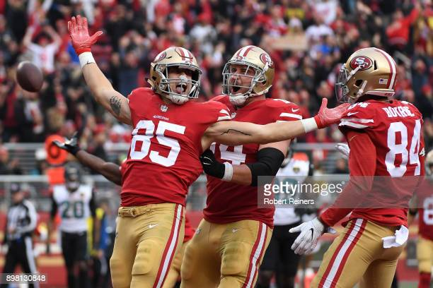 George Kittle of the San Francisco 49ers celebrates after scoring on a eightyard touchdown catch against the Jacksonville Jaguars during their NFL...