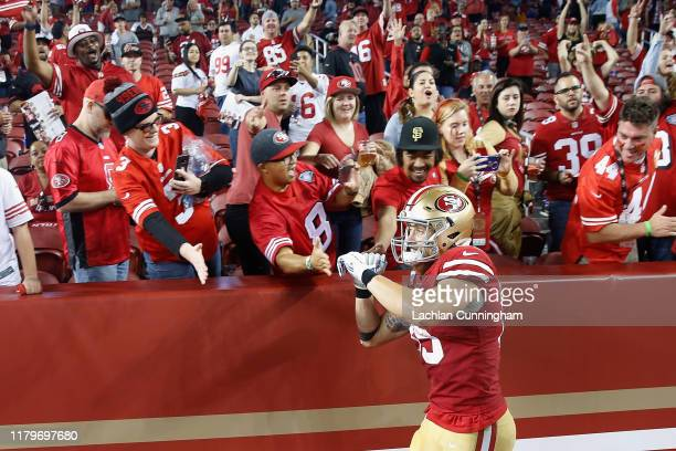 George Kittle of the San Francisco 49ers celebrates with fans after a win against the Cleveland Browns at Levi's Stadium on October 07, 2019 in Santa...