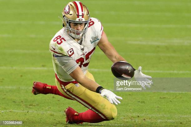 George Kittle of the San Francisco 49ers dive to catch the ball against the Kansas City Chiefs in Super Bowl LIV at Hard Rock Stadium on February 02...