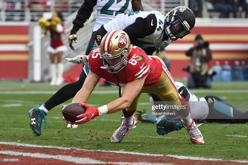 George Kittle #85 of the San Francisco 49ers dives into the end zone for a touchdown against the Jacksonville Jaguars during their NFL game at Levi's Stadium on December 24, 2017 in Santa Clara, California.