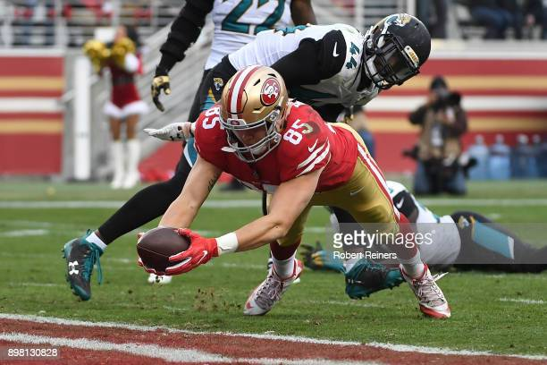 George Kittle of the San Francisco 49ers dives into the end zone for a touchdown against the Jacksonville Jaguars during their NFL game at Levi's...
