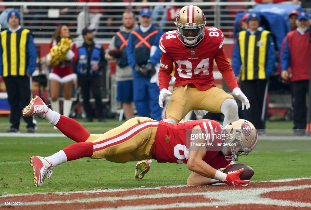 George Kittle #85 of the San Francisco 49ers dives over the line for a 7-yard touchdown catch against the Jacksonville Jaguars during their NFL football game at Levi's Stadium on December 24, 2017 in Santa Clara, California.