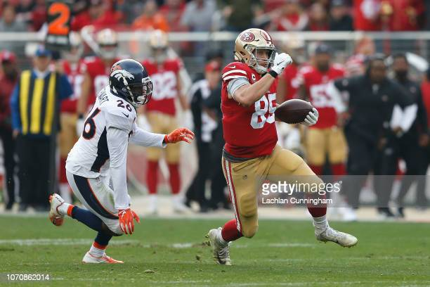 George Kittle of the San Francisco 49ers evades a tackled by Darian Stewart of the Denver Broncos at Levi's Stadium on December 9 2018 in Santa Clara...
