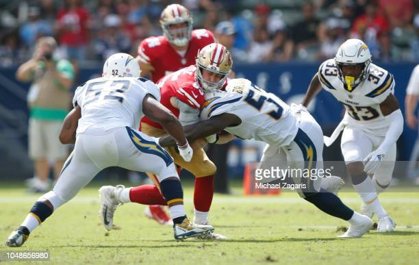 George Kittle of the San Francisco 49ers gets tackled after making a reception during the game against the Los Angeles Chargers at StubHub Center on...