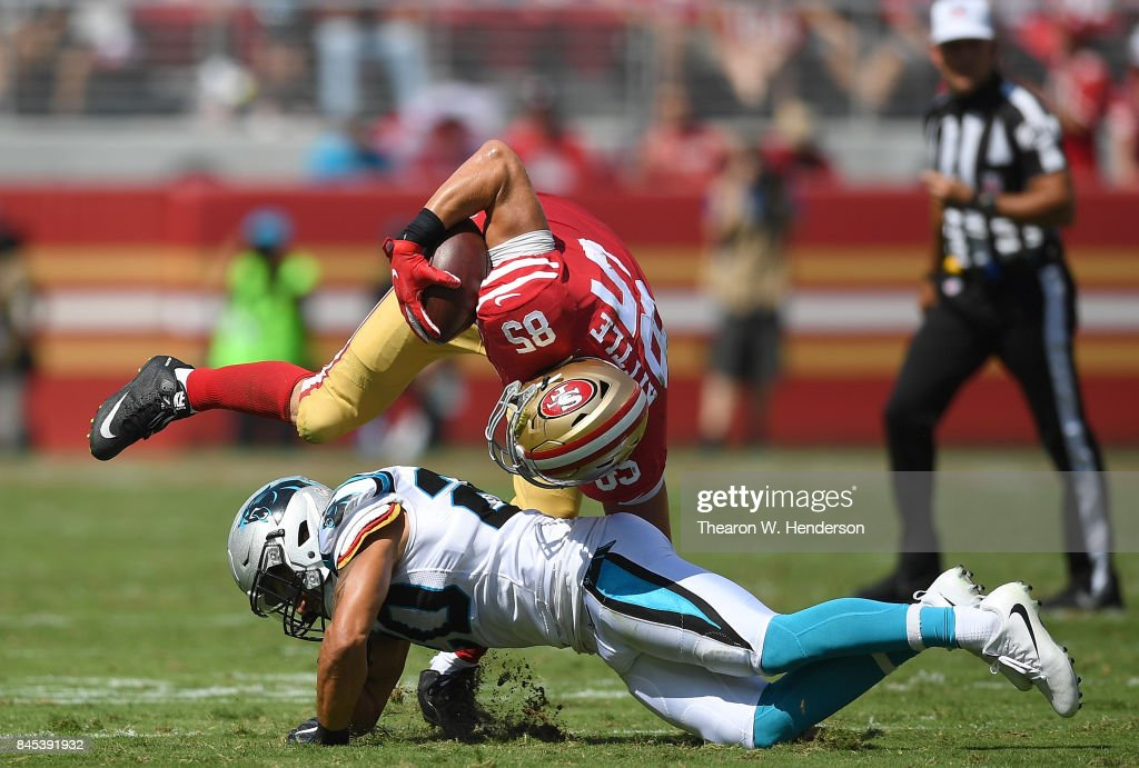 George Kittle #85 of the San Francisco 49ers gets tackled by Kurt Coleman #20 of the Carolina Panthers during the second quarter of their NFL football game at Levi's Stadium on September 10, 2017 in Santa Clara, California.