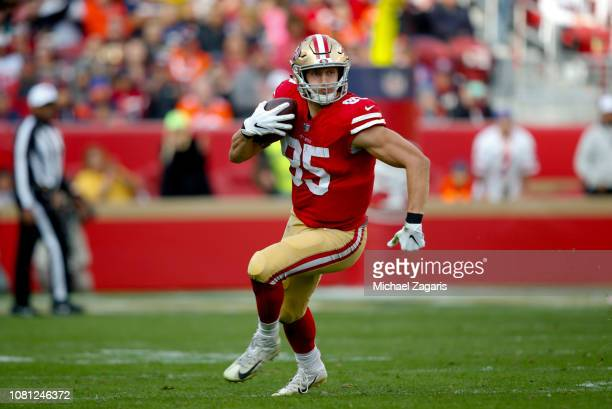 George Kittle of the San Francisco 49ers heads to the end zone on a 85yard touchdown reception during the game against the Denver Broncos at Levi's...
