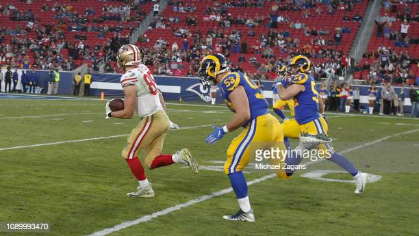 George Kittle of the San Francisco 49ers heads to the end zone on a 43yard touchdown reception a reception the set the single season mark for most...