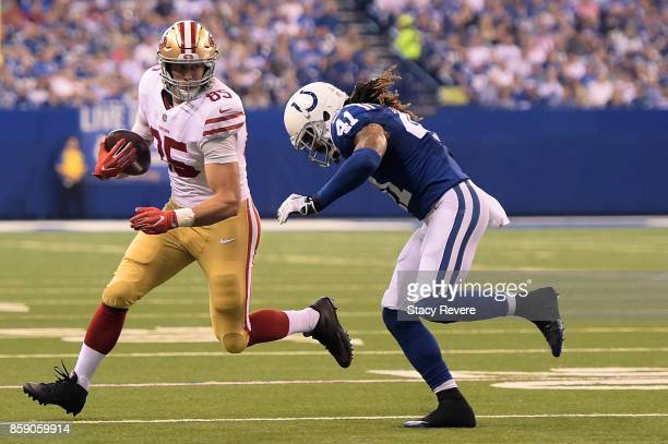 George Kittle of the San Francisco 49ers is pursued by Matthias Farley of the Indianapolis Colts during the first quarter of a game at Lucas Oil...