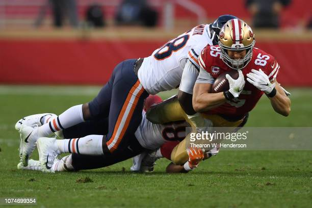 George Kittle of the San Francisco 49ers is tackled after a catch against the Chicago Bears during their NFL game at Levi's Stadium on December 23...